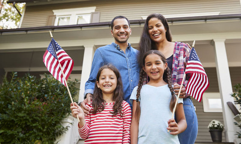 family-holding-flags